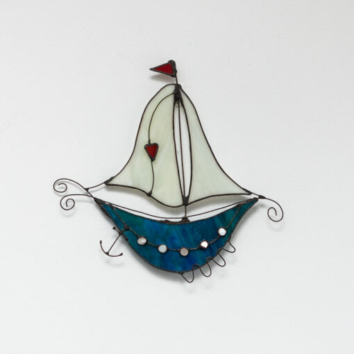 Fantasy boat turquoise with cream sails