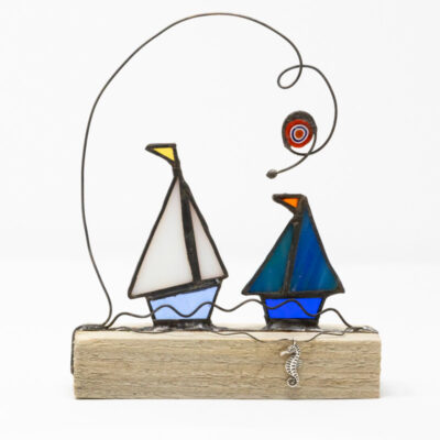 Sailing boat duo with seahorse