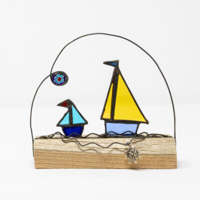 Sailing boat duo on wood