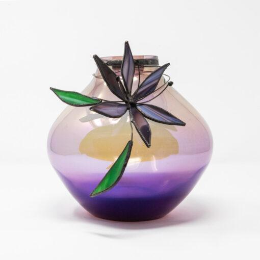 purple iridised vase with flower