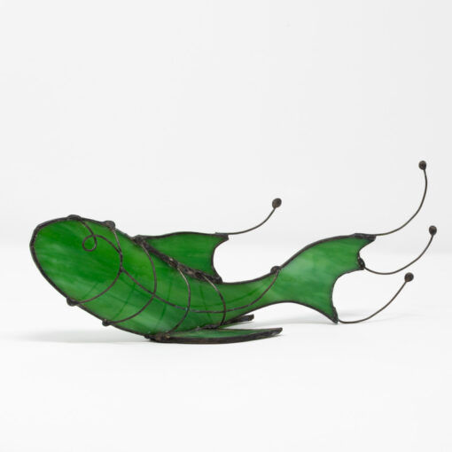 green standing fish sculpture