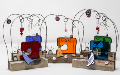 Sewing machine sculptures in stained glass