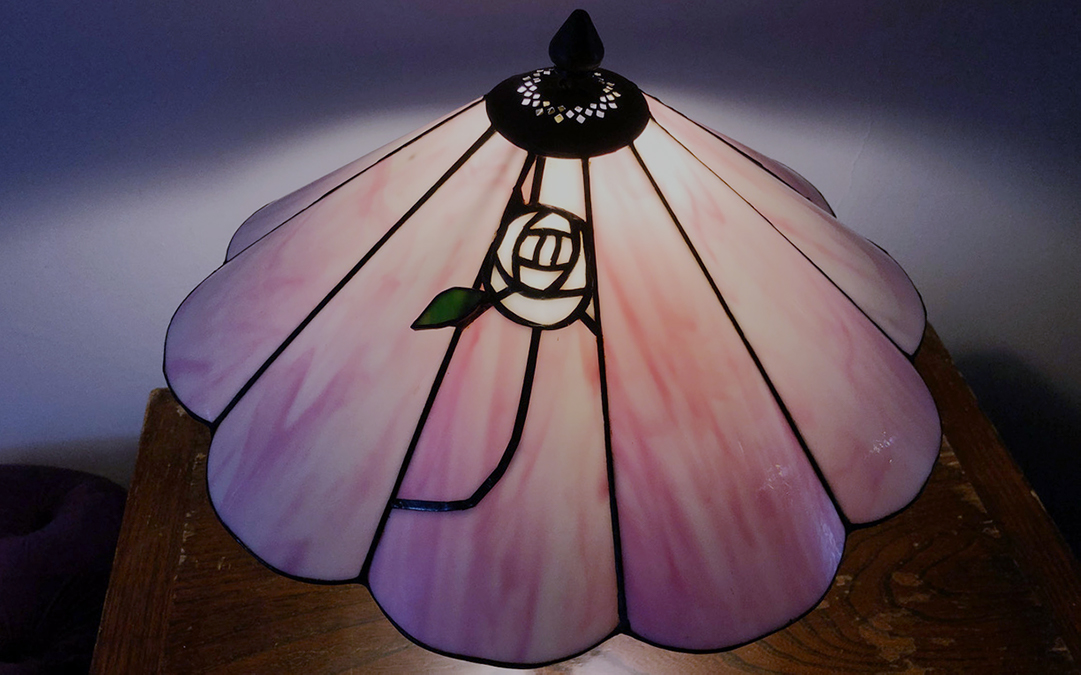 Repair to stained glass Tiffany lamp with curved panels