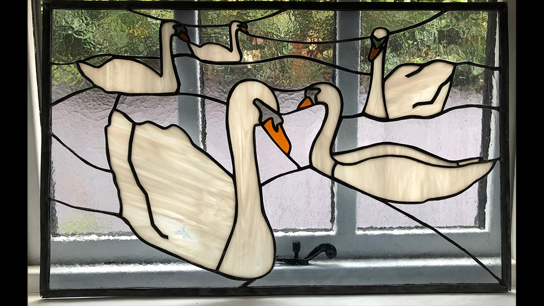 Stained glass swans swim to Southsea