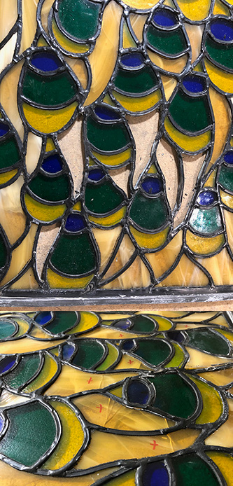 Detail of broken peacock stained glass window
